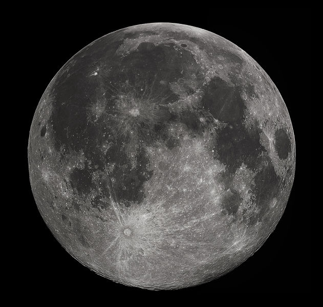 "Near side of the moon, as seen through a telescope. The moon looks round, but it isn't. In a dark sky, the moon looks bright white, but this image captures its true asphalt gray color. Notice that the moon's near side has dark ""maria"" or ""seas,"" while the moon's far side (photo at top of post) lacks these features. Image via Wikimedia Commons."
